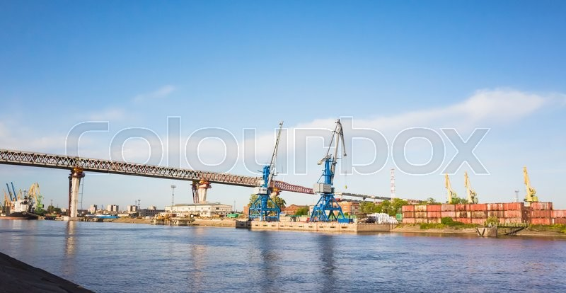 Editorial image of 'St-Petersburg, Russia - June 7, 2016: Saint-Petersburg Western Rapid Diameter. Construction of the viaduct over Big Sea Canal on Kanonersky island'