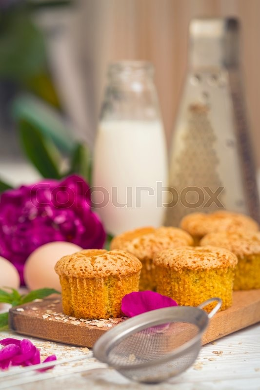 Stock image of 'cupcakes. small tasty and healthy muffins on the kitchen table\'