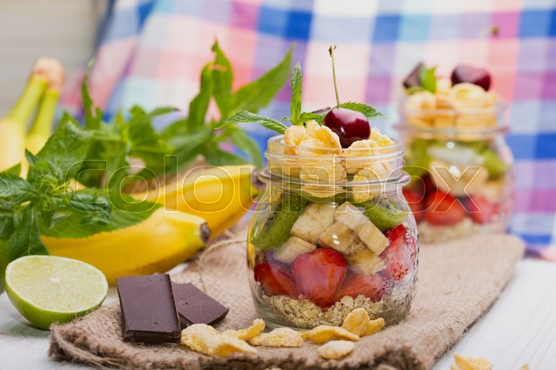 Stock image of 'healthy diet. breakfast - oatmeal with berries and fruits on the kitchen table\'