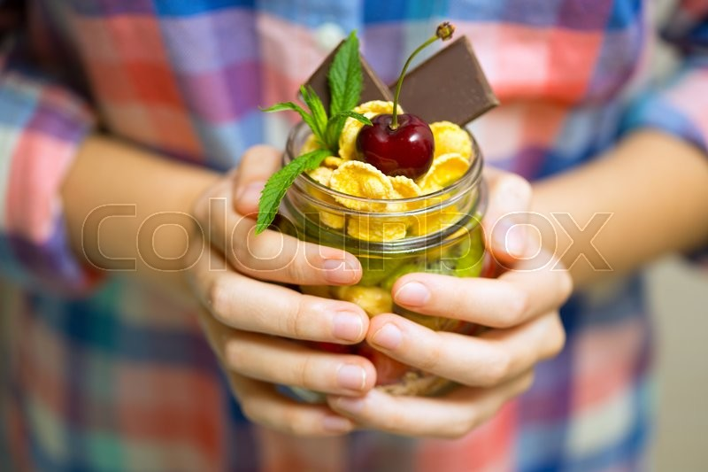 Stock image of 'healthy diet. girl holding oatmeal with berries and fruits\'