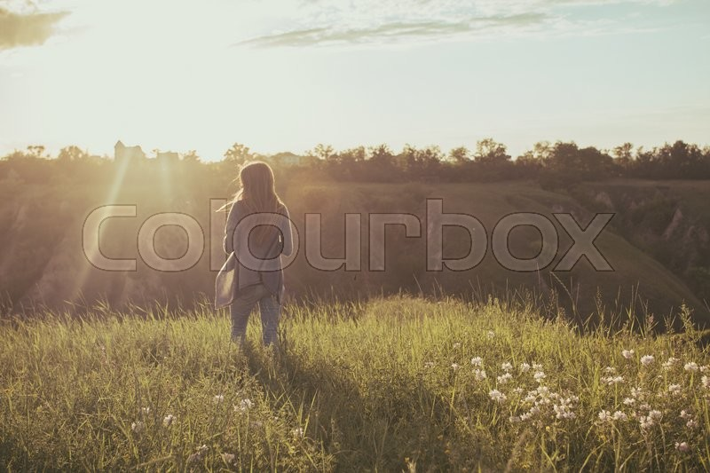 Stock image of 'freedom - girl on the nature in sunset time '