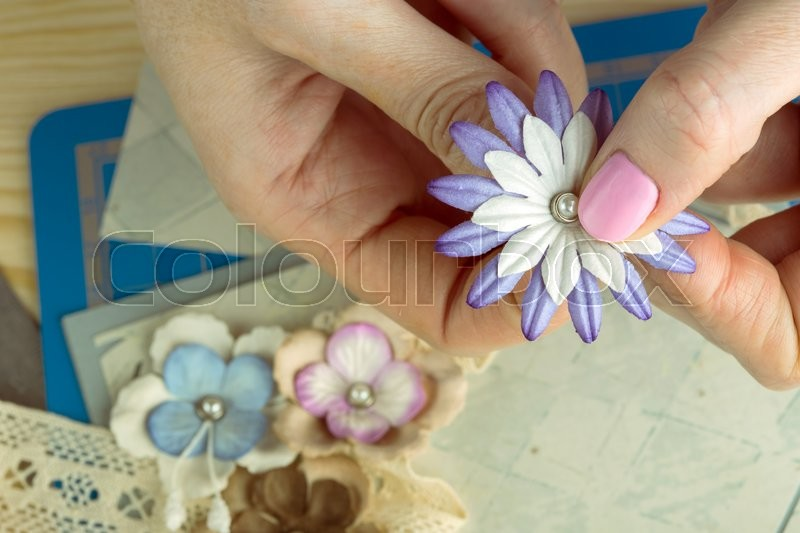 Stock image of 'scrapbook background. Hands, Card and tools with decoration. \'