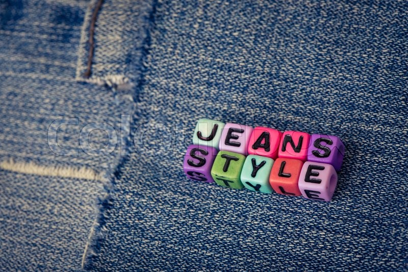Stock image of 'cubes with letters jeans style on a jeans background\'