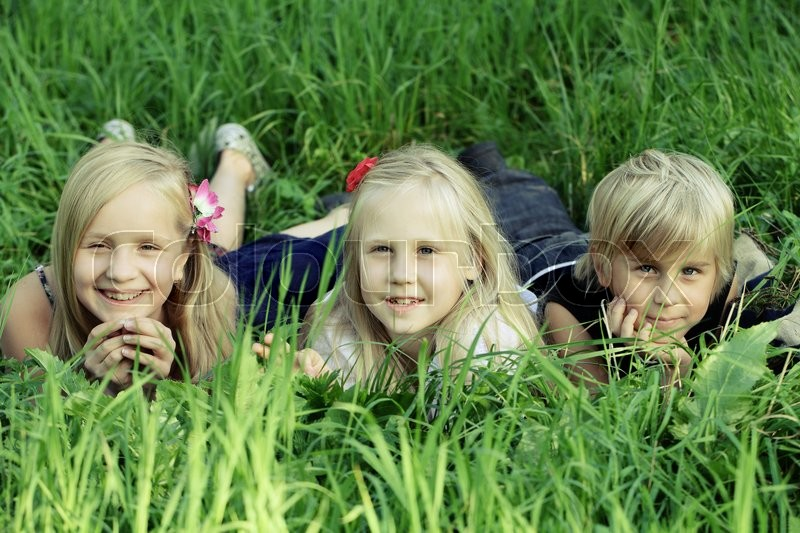 Stock image of 'Cute children outdoors, kids in summer grass'