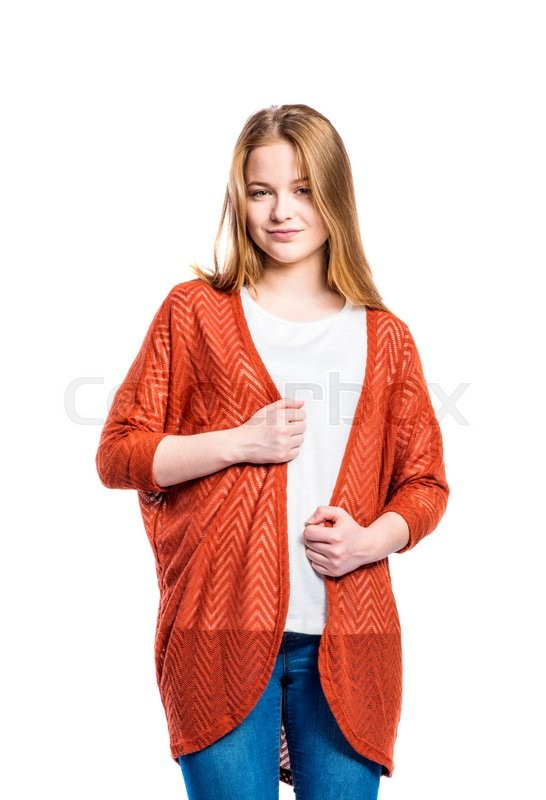 Stock image of 'Teenage girl in jeans and long orange sweater, young woman, studio shot on white background, isolated'