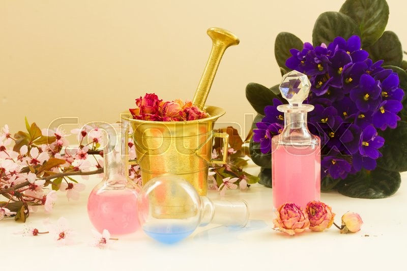 Stock image of 'Dry flowers, mortar and glass bottles of potions, herbal medicine'
