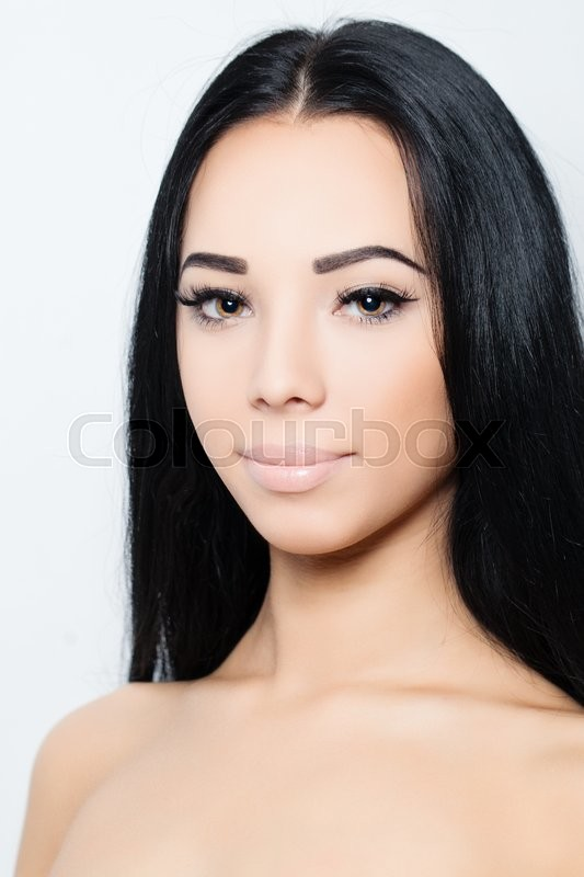 Stock image of 'Woman with long hair and makeup'