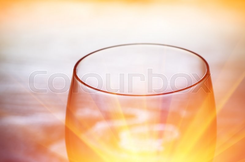 Stock image of 'An empty hot glass in a dark room soft focus'