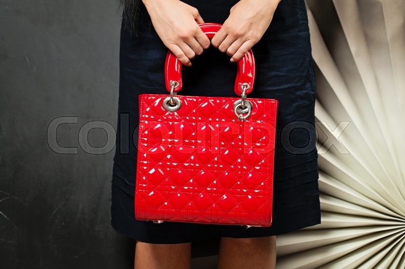 Stock image of 'Hand Bag. Woman with Red Handbag on Background'