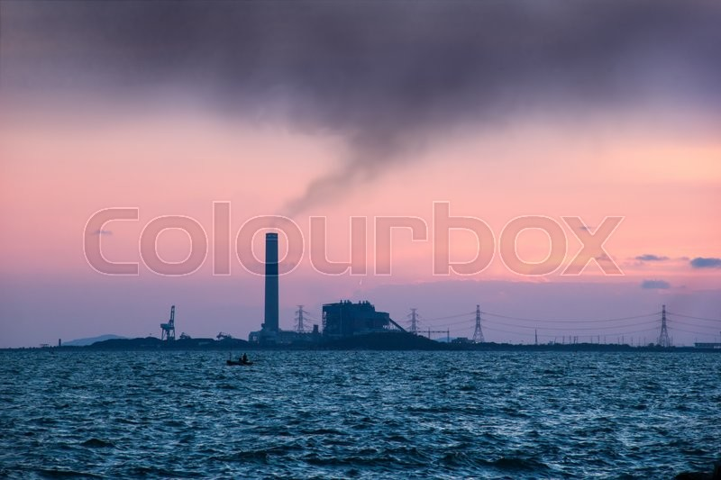 Stock image of 'Sunset view of the heavy industry with smoking chimneys'
