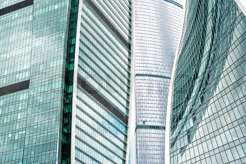Stock image of 'modern skyscrapers of iron and glass reflecting background'