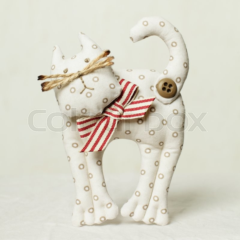 Stock image of 'Cat toy and textile and sewing accessory'