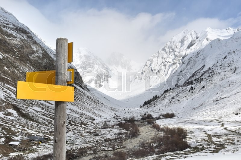 Stock image of 'hiking sign on background snowy mountain in Alps'
