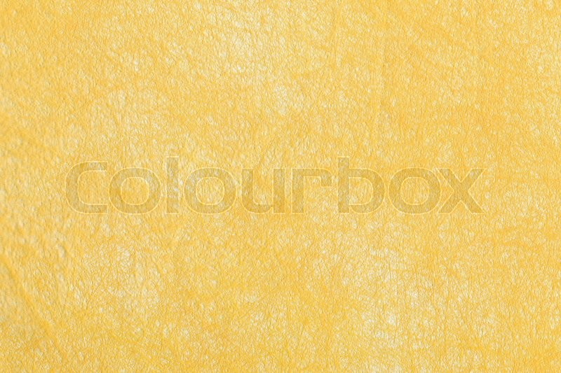 Stock image of 'Blank piece of yellow paper as background. Close-up.'