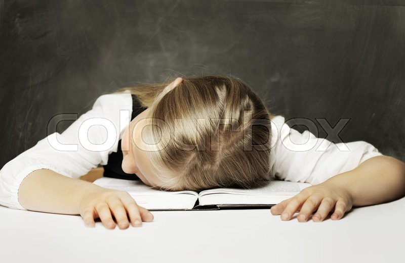 Stock image of 'Tired schoolgirl with books'