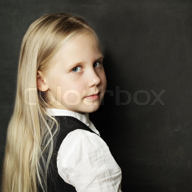 Stock image of 'Pupil with school blackboard, face closeup'