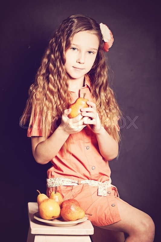 Stock image of 'Young Girl with Fruit. Cute Face, Orange Dress'