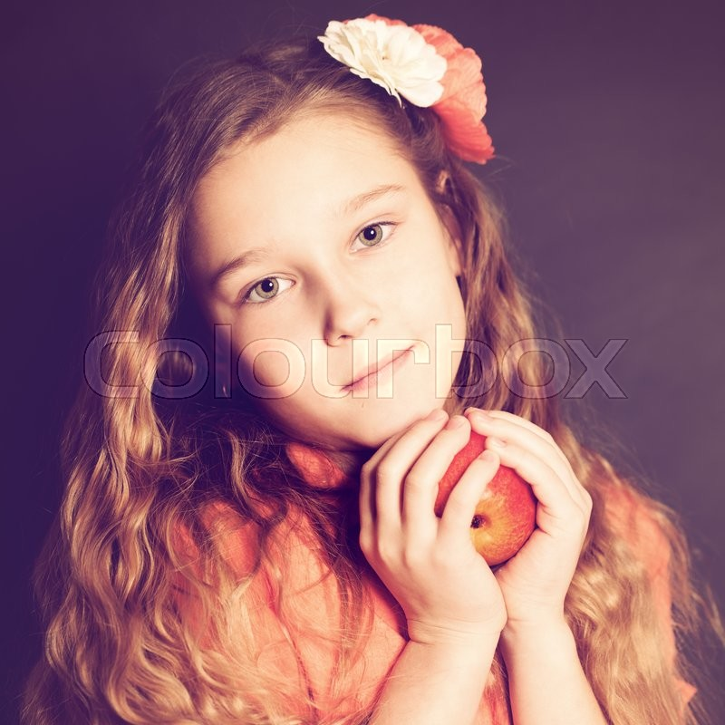 Stock image of 'Girl holding Apple Fruit. '