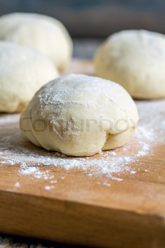 Stock image of 'Billets dough for baking buns on a floured table.'