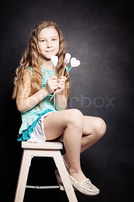 Stock image of 'Cute Child Girl. Portrait on dark background'