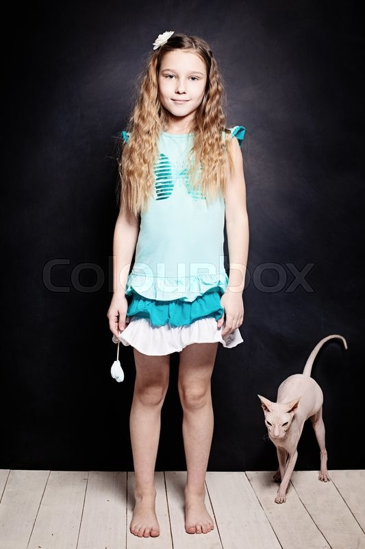 Stock image of 'Girl and Kitten. Child with Cat. Two Friends'