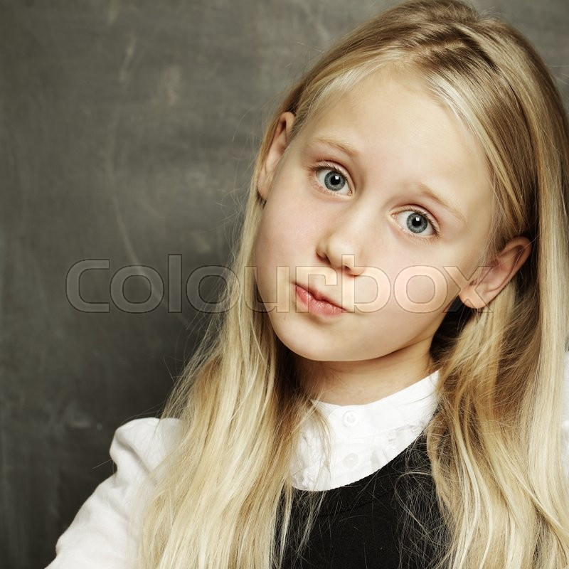 Stock image of 'Cute girl - pupil at school '