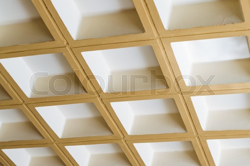 Stock image of 'Modern white concrete ceiling of the square blocks in the constructivist architectural style, 3D background, stone texture from parallelepipeds. Bali, Rethymno, Crete, Greece'