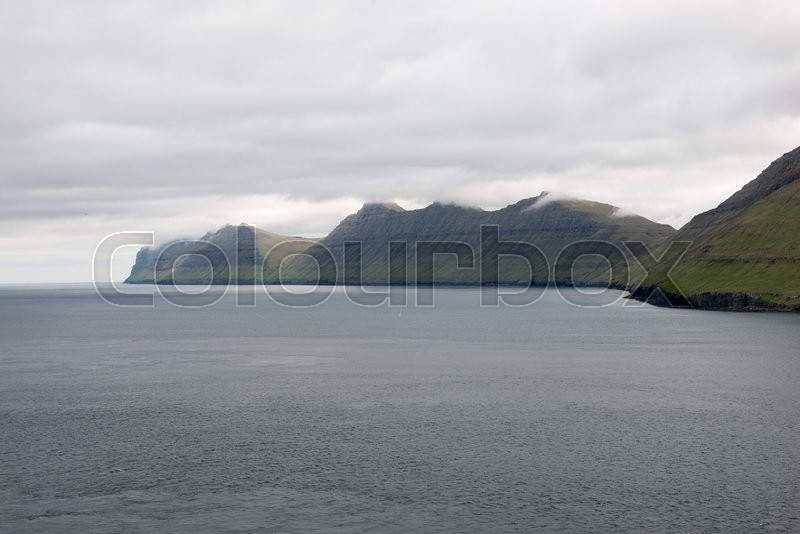 Stock image of 'Typical landscape on the Faroe Islands, with Kalsoyarfjørdur, the fjord between kalsoy and kunoy'