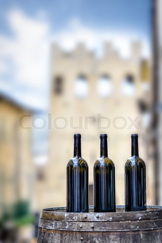 Stock image of 'Wine bottles on a barrel in the town of Montefalco in Italy'