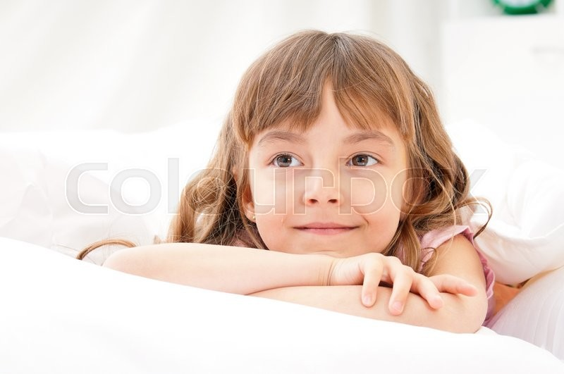 Stock image of 'Adorable little girl awaked up in her bed'