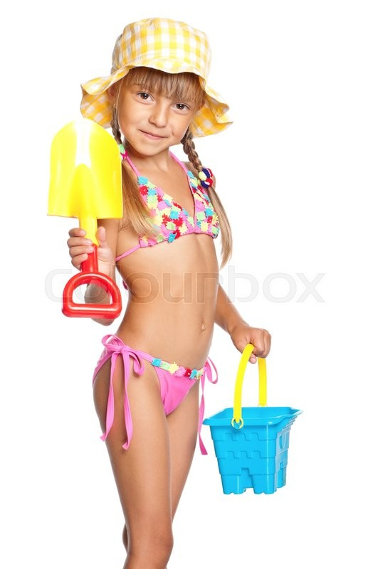 Stock image of 'Adorable little girl standing in swimming wear and panama hat with bucket and spade, isolated on white background'