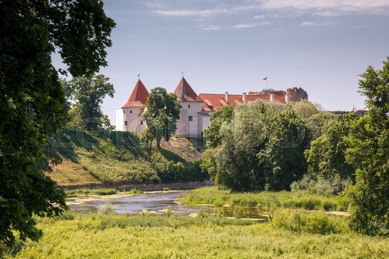 Stock image of 'An old Bauskas castle in Latvia in rural surroundings'