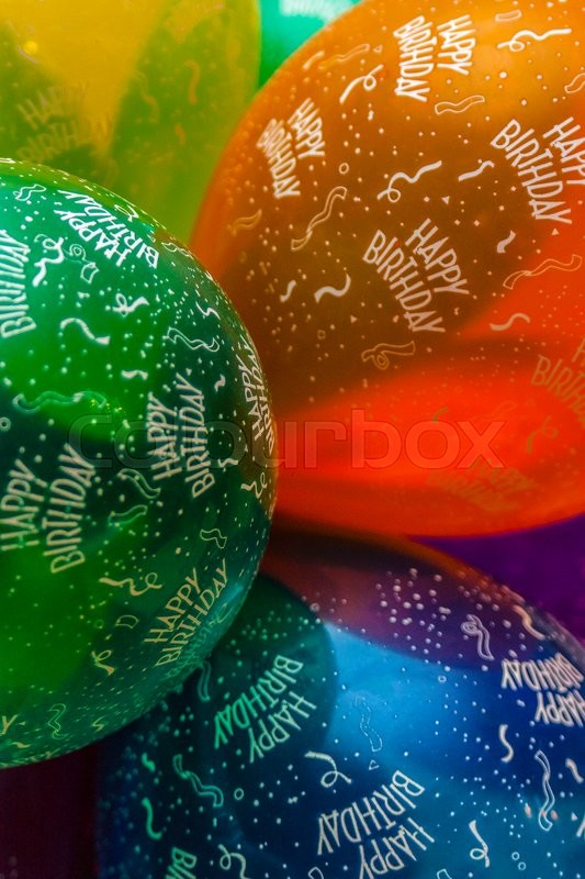 Stock image of 'A bunch of colorful birthday balloons'