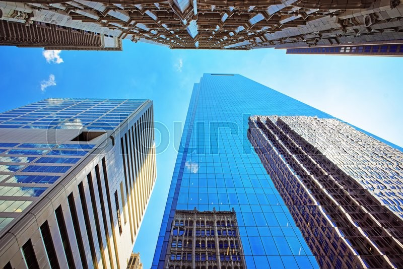 Stock image of 'Bottom up view on skyscrapers mirrored in glass in Philadelphia, Pennsylvania, USA. It is central business district in Philadelphia'