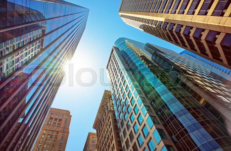 Stock image of 'Bottom-up view of skyscrapers mirrored in glass in Philadelphia, Pennsylvania, USA. It is central business district in Philadelphia'