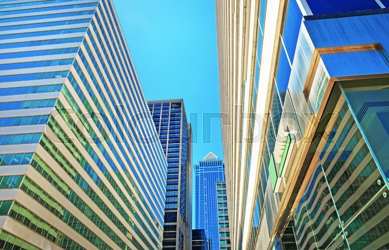 Stock image of 'Bottom up view of skyscrapers reflected in glass in Philadelphia, Pennsylvania, USA. It is central business district in Philadelphia'