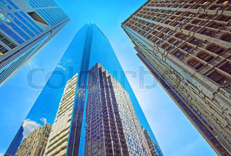 Stock image of 'Bottom-up view of skyscrapers reflected in glass in Philadelphia, Pennsylvania, USA. It is central business district in Philadelphia'