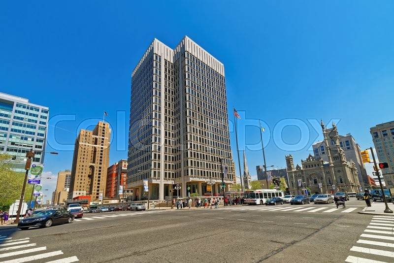 Stock image of 'Municipal Services Building and skyscrapers in Philadelphia, Pennsylvania, USA. It is central business district in Philadelphia. Road view. Tourists in the street.'
