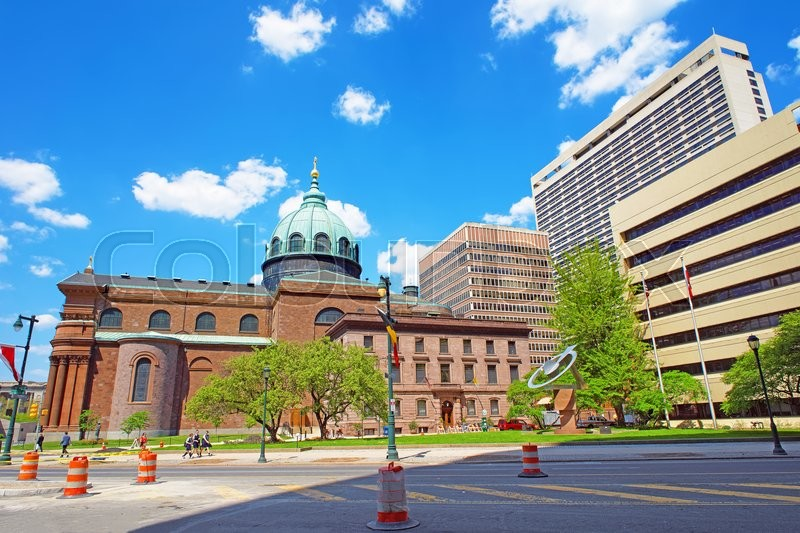 Stock image of 'Cathedral Basilica of Sts Peter and Paul of Philadelphia Pennsylvania, USA.  It is also called as Roman Catholic Archdiocese of Philadelphia. Tourists in the street'