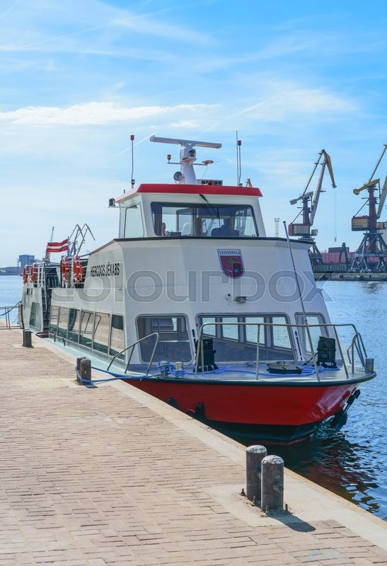Editorial image of 'Ventspils, Latvia - May 8, 2016: Excursion Ferry on the Venta River in Ventspils, Latvia. Ventspils a city in the Courland region of Latvia. Latvia is one of the Baltic countries'