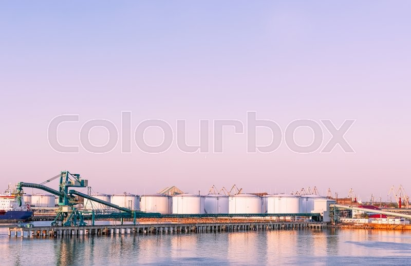 Stock image of 'Oil bunkers at Marina in Ventspils at sundown. Ventspils a city in the Courland region of Latvia. Latvia is one of the Baltic countries'