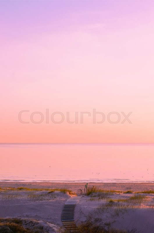 Stock image of 'Beach at sunset in Ventspils in the Baltic Sea, Latvia. Ventspils a city in the Courland region of Latvia. Latvia is one of the Baltic countries'
