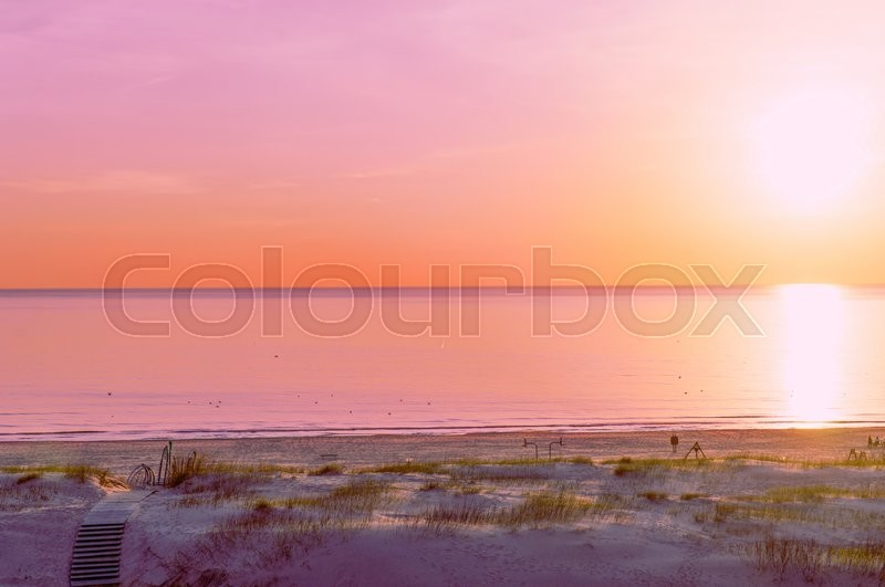 Stock image of 'Beach at sunset in Ventspils, the Baltic Sea, Latvia. Ventspils a city in the Courland region of Latvia. Latvia is one of the Baltic countries'