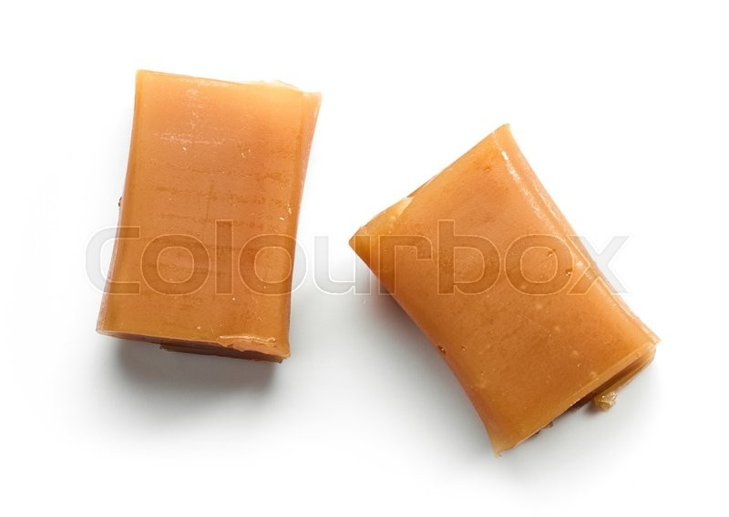 Stock image of 'caramel candies isolated on white background, top view'