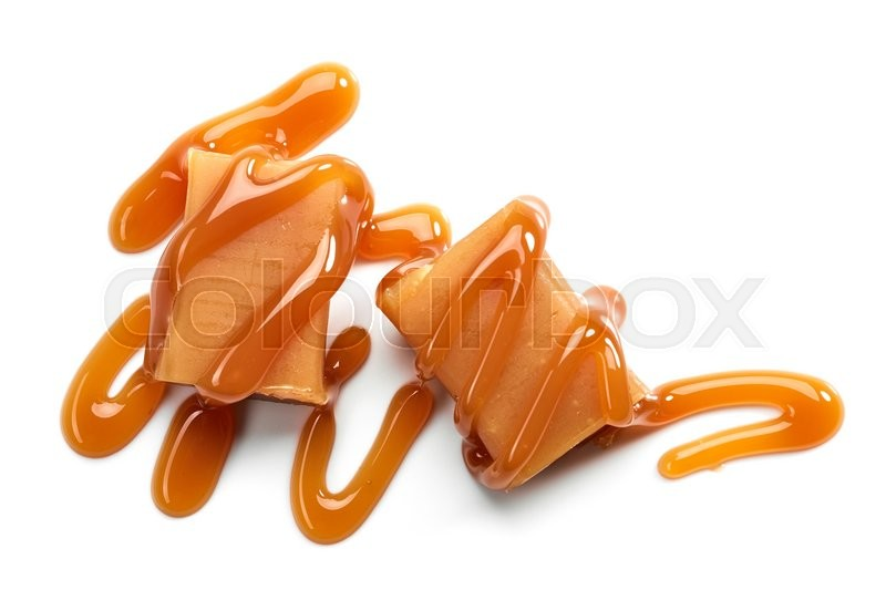 Stock image of 'caramel candies and sweet sauce isolated on white background, top view'