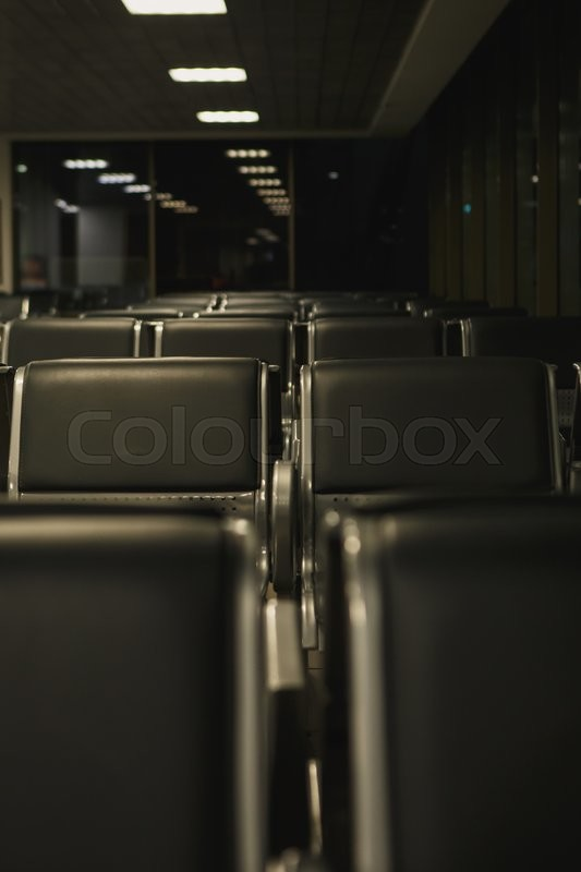 Stock image of 'the rows of empty seats in an airport lounge'