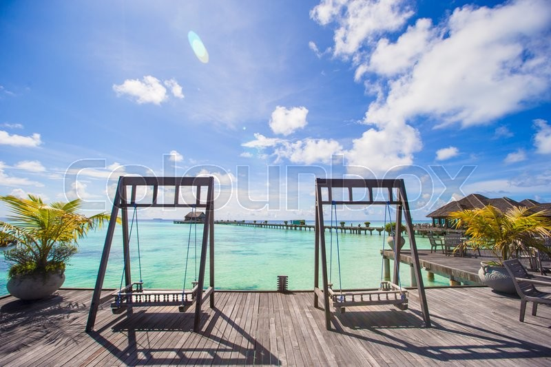 Stock image of 'Beautiful tropical view of perfect ideal island, wooden jetty and turquiose water'