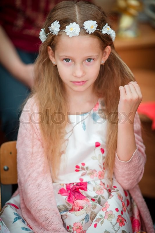 Stock image of 'Portrait of adorable beautiful little girl indoors'