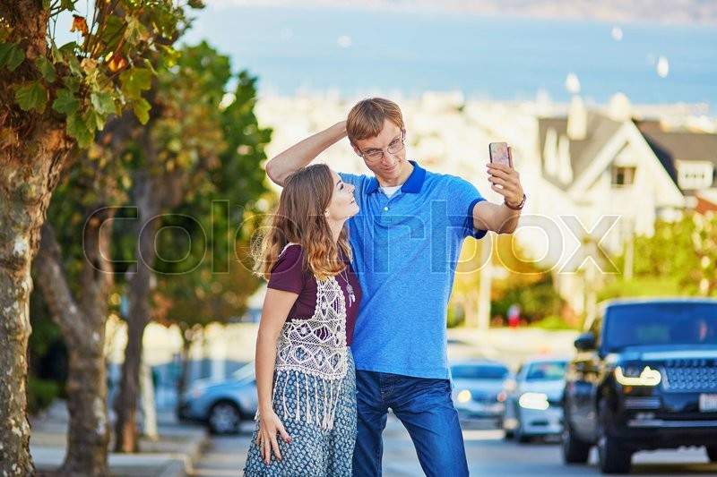 Stock image of 'Romantic loving couple making selfie in San Francisco, California, USA'