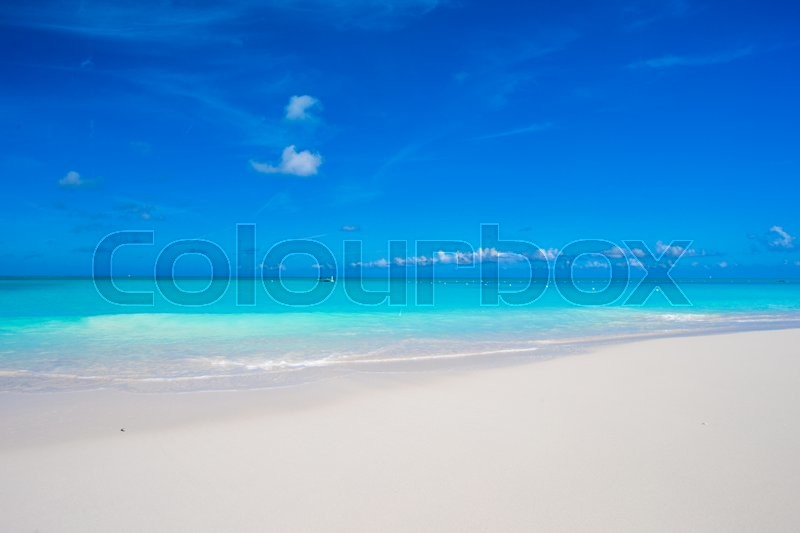 Stock image of 'Beautiful white sand beach and turquoise clean water on tropical exotic island'